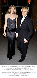 Musician NICK RHODES and MEREDITH OSTROM, at a ball in London on 12th December 2002.PGE 69