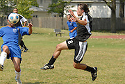 Fabian Ramirez of Deportivo Colomex (right) competes for control of the ball against Team Shlama F.C. during National Soccer League play in Skokie, Il.