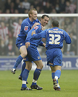 Photo: Aidan Ellis.<br /> Lincoln City v Grimsby Town. Coca Cola League 2, Play off Semi Final. 13/05/2006.<br /> grimsby's Paul Bolland jumps on goal scorer Gary Jones back to celebrate the first goal with Curtis Woodhouse