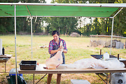 Megan Denton of Able Farms butchers a pig in the old fashioned way which uses every part of the animal.