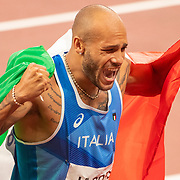 TOKYO, JAPAN August 1:  Lamont Marcell Jacobs of Italy celebrates after winning the 100m Final during the Track and Field competition at the Olympic Stadium  at the Tokyo 2020 Summer Olympic Games on July 31, 2021 in Tokyo, Japan. (Photo by Tim Clayton/Corbis via Getty Images)