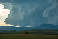 A wall cloud descends behind Crow Peak in the Black Hills. Not long afterwards a tornado would knock down parts of the forest.