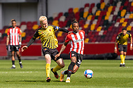 Watford midfielder Will Hughes (19) chases Brentford Midfielder Tariqe Fosu-Henry(#24) during the EFL Sky Bet Championship match between Brentford and Watford at Brentford Community Stadium, Brentford, England on 1 May 2021.