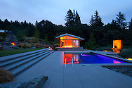 """The evening view of the swimming pool, yoga pavilion designed by architect Michael McCulloch and Lee Kelly's sculpture entitled """"Window to the Gone World"""""""