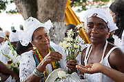 Bahianas in tradtional Candomble Umbanda dress blessing people, Every second 2nd Thursday in February thousands of people attend the Lavagem do Bonfim - The washing of Bonfim at the Iglesia do Bonfim - Church of Bonfim in Salvador de Bahia,