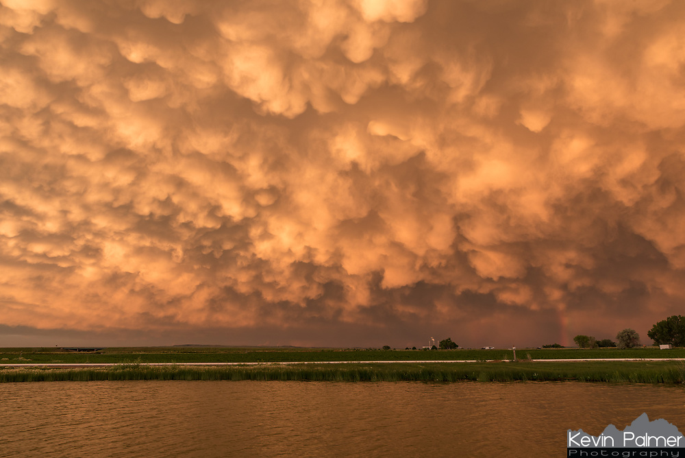 I stopped in Wheatland to grab dinner with a long drive home ahead of me. But when I saw this sunset developing, I knew I had to find a spot nearby to capture it. A severe MCS (mesoscale convective system) had moved off to the east. Underneath the anvil of this storm were mammatus clouds, which lit up like crazy as the sun went down. I've never seen a sunset quite like this.