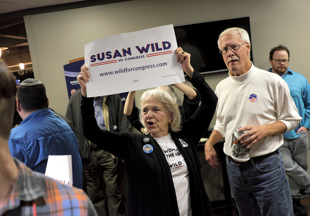 A supporter of Susan Wild, Democratic candidate for Pennsylvania's new 7th Congressional District, celebrates a victory in the race during an Election Night event Nov. 6, 2018, at Coca-Cola Park in Allentown, Pennsylvania.