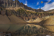 Small pond reflects Swiftcurrent Mountain in Glacier National Park, Montana, USA