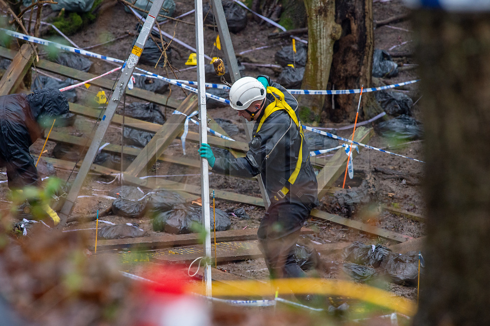 © Licensed to London News Pictures. 17/12/2019. Beaconsfield, UK. A member of the search team wearing a dry suit and a harness stands by a tripod hoist stand at an ingress point to what appears to be an underground area. London's Metropolitan Police Service have called in the forces specialist Under Water and Confined Space Search Team as they continue to search woodland in Beaconsfield. The Met confirmed on 12th December 2019 they are searching the woodland in Beaconsfield, Buckinghamshire in connection with the disappearance and murder of Mohammed Shah Subhani. Police have been in the area conducting operations on Hedgerley Lane since Thursday 5th December 2019 and are combing wooded area with specialist officers assisted by specialist search dogs. Photo credit: Peter Manning/LNP