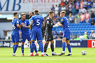 Cardiff City players fist bump one another before the EFL Sky Bet Championship match between Cardiff City and Bristol City at the Cardiff City Stadium, Cardiff, Wales on 28 August 2021.