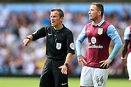 referee Keith Stroud makes a point as Ross McCormack of Aston Villa looks on. EFL Skybet championship match, Aston Villa v Rotherham Utd at Villa Park in Birmingham, The Midlands on Saturday 13th August 2016.<br /> pic by Andrew Orchard, Andrew Orchard sports photography.
