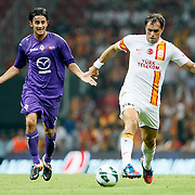 Galatasaray's Johan Elmander (R) and ACF Fiorentina's during their friendly soccer match Galatasaray between ACF Fiorentina at the TT Arena in istanbul Turkey on Wednesday 08 August 2012. Photo by TURKPIX