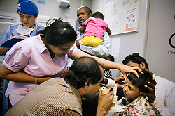 A doctor examines a young patient onboard the ORBIS Flying Eye Hospital in Kolkata, India.