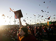 Esperanza High's graduating class of 2006 celebrate after receiving their diplomas during commencement ceremonies Tuesday, June 13, 2006 at Valencia High School in Placentia.