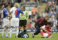 Photo: Aidan Ellis.<br /> Blackburn Rovers v Arsenal. The FA Barclays Premiership. 19/08/2007.<br /> Blackburn's David Dunn and Robbie Savage ask the referee for explanations after another suspect Arsenal injury as Eduardo is tended to by the Arsenal physio
