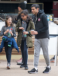 **Children's faces pixelated**<br /> © Licensed to London News Pictures. 03/04/2021. London, UK. Chancellor of the Exchequer RISHI SUNAK  is seen relaxing with his family near Downing Street in Westminster. On April 12th England is set to relax more lockdown restrictions which were imposed to control the spread of COVID-19. Photo credit: Ben Cawthra/LNP