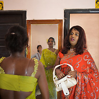 Aravanis prepare themselves for a beauty pageant in Vilappuram...India's transexual community has a recorded history of more than four thousand years. Many consider the The Third Sex, also known as Aravanis, to posses special powers allowing them to determine the fate of others. As such, they are not only revered but despised and feared too. Resigned to the fringes of society, segregated and excluded from most occupations, many Aravanis are forced to turn to begging and sex work in order to earn a living. ..The annual transgender festival in the village of Koovagam, near Vilappuram, offers an escape from this often desolate existence. For some, the week-long partying and frenetic sex trade that culminates in the Koovagam festival is about fulfilling lustful desires. For others, the gathering provides a chance for transgenders to bond, share experiences, join the wider homosexual gay-community and coordinate their campaign for recognition and tackle the challenge of HIV/AIDS. ..It is the Indian state of Tamil Nadu that the eighty-thousand-strong Aravani community has made advances in their fight for rights. In 2009, the Tamil Nadu state government began providing sex-change surgery free of cost. The state has also offers special third-gender ration cards, passports and reserved seats in colleges. And 2008 the launch of Ippudikku Rose, a Tamil talk-show fronted by India's first transgender TV-host and the release of a mainstream Tamil film staring an Aravani in the lead-role. ..These advances clearly signal a victory for south India's transgenders, but they have also exposed deep divisions within the community. There is a very real gulf that separates the majority poor from their potentially influential but often reticent, upper-class sisters. ..Photo: Tom Pietrasik.Vilappuram District, Tamil Nadu. India.May 2009