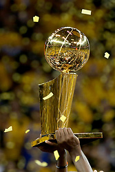 The Golden State Warriors hold up the Larry O'Brien trophy as they celebrate their championship after defeating the Cleveland Cavaliers, 129-120, in Game 5 of the NBA Finals at Oracle Arena in Oakland, Calif., on Monday, June 12, 2017. (Photo by Ray Chavez/Bay Area News Group/TNS) *** Please Use Credit from Credit Field ***