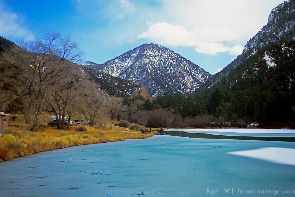 USA, New Mexico, Taos County.  A frozen lake near Mt. Wheeler in the Taos Mountain Range on a clear winter's day.