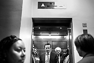Senators Bernie Sanders and Chris Murphy ride in the Senators Only elevators on Capitol Hill in Washington, D.C. on June 26, 2017. The pair are headed to vote just as the Congressional Budget Office report came out saying 22 million more Americans would be uninsured by the end of the coming decade with the passage of the Senate healthcare bill. (photo by Melina Mara/The Washington Post)