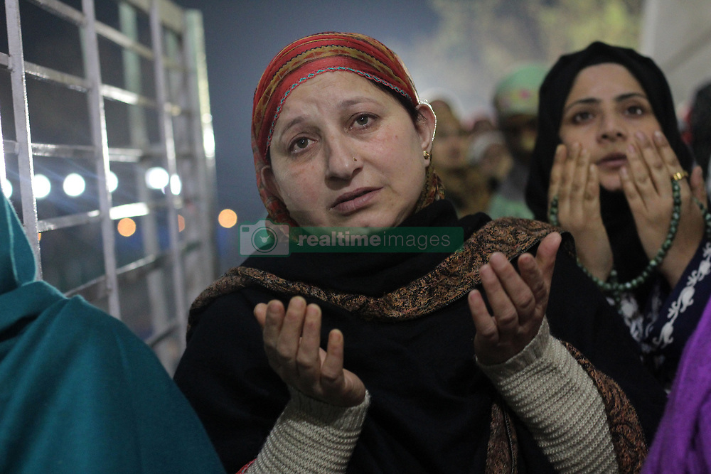 November 20, 2018 - Srinagar, India - Kashmiri Muslim women devotees pray after Isha prayers on the night of Eid-e-Milad, or the birth anniversary of prophet Mohammad in Hazratbal shrine situated in the outskirts of Srinagar, the summer capital of Indian administered. (Credit Image: © Masrat Zahra via ZUMA Wire)