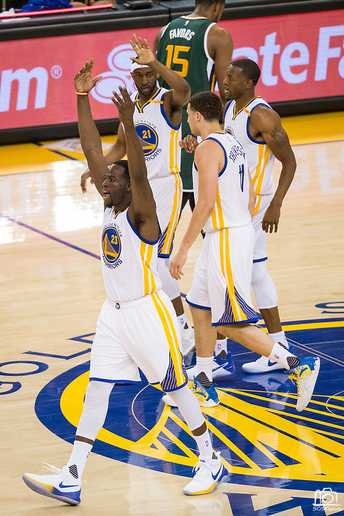 Golden State Warriors forward Draymond Green (23) celebrates a basket during Game 1 of the Western Conference Semifinals against the Utah Jazz at Oracle Arena in Oakland, Calif., on May 2, 2017. (Stan Olszewski/Special to S.F. Examiner)