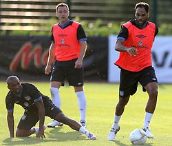 England's Joleon Lescott during training with Jermain Defoe (left) and John Terry