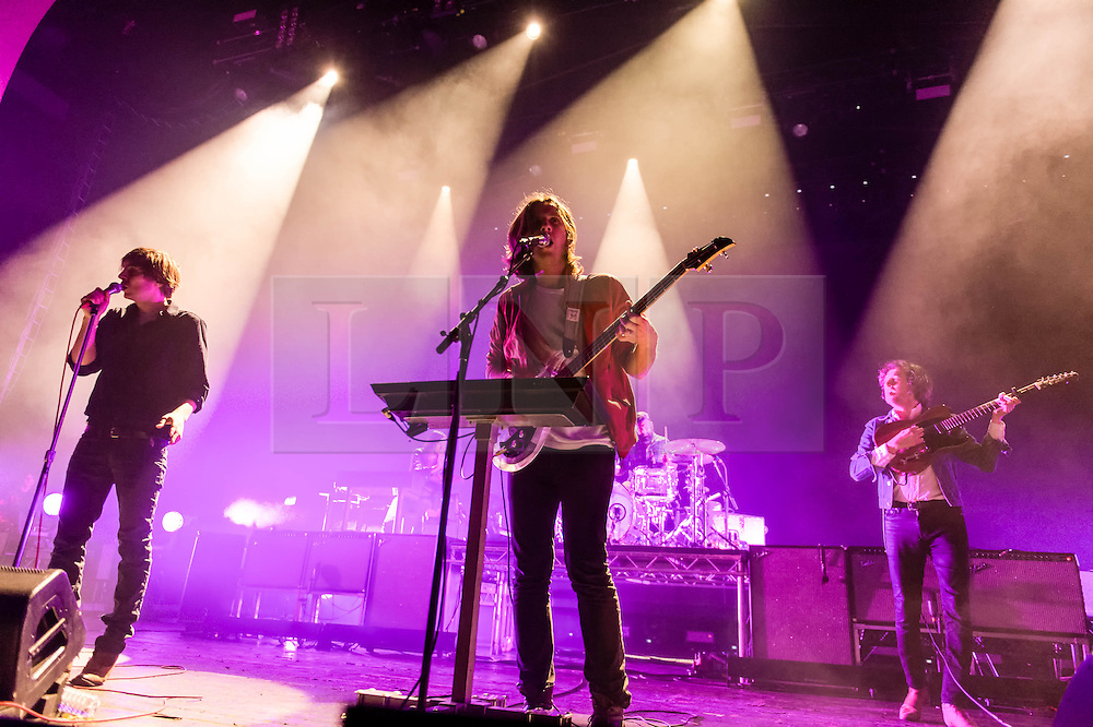 © Licensed to London News Pictures. 12/02/2014. London, UK.   Phoenix performing live at Brixton Academy.  In this picture - Thomas Mars (left), Deck D'Arcy (centre), Christian Mazzalai  (right). Phoenix is a french alternative rock band comprising of members Thomas Mars (vocals), Deck D'Arcy (Bass,Keyboards), Laurent Brancowitz (guitar, keyboards), Christian Mazzalai (guitar).  Photo credit : Richard Isaac/LNP