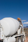 Vertical of man on cement mixer on high mesa<br />