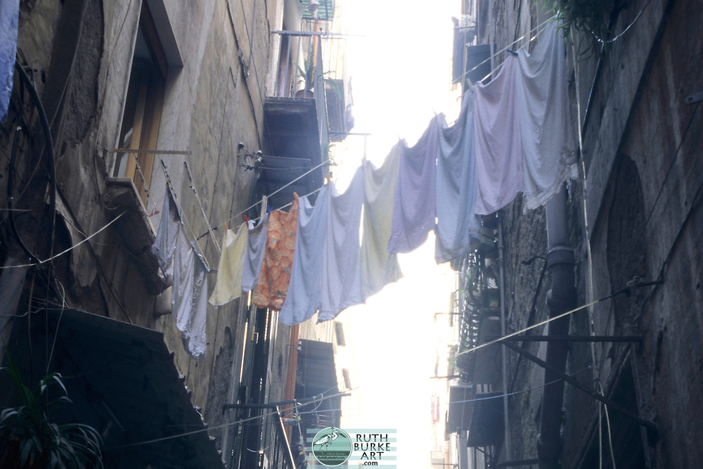"""Naples (Italian: Napoli [ˈnaːpoli] ( listen), Neapolitan: Napule [ˈnɑːpələ]; Latin: Neapolis; Ancient Greek: Νεάπολις, meaning """"new city"""") is the capital of Campania and the third-largest municipality in Italy, after Rome and Milan. As of 2012, around 960,000 people live within the city's administrative limits. The Naples urban area, covering 1,023 km2 (395 sq mi),[3] has a population of between 3 million[4] and 3.7 million,[3] and is the 8th-most populous urban area in the European Union. Between 4.1 and 4.9 million people live in the Naples metropolitan area, one of the largest metropolises on the Mediterranean Sea.[2]"""
