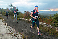 High Point, New Jersey - Runners head down the trail past the High Point Monument at the start of the  The Shawangunk Ridge Trail Run/Hike 70-mile race at High Point State Park on Sept. 15, 2017.