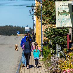 A couple and their two daughters take a walk in downtown Lubec, Maine.