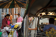Street vendors by the Oriental Hotel