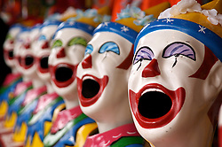 Funfair ball game with target in mouths of clowns heads at annual Melbourne Fair in Australia