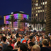 The crowd is seen during a vigil at the Dr. Phillips Center for the Performing Arts for the victims of a mass shooting at the Pulse nightclub Monday, June 13, 2016, in Orlando, Florida.  A gunman killed dozens of people in a massacre at the crowded gay nightclub in Orlando on Sunday, making it the deadliest mass shooting in modern U.S. history. (Alex Menendez via AP)