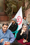 A man with a flag and other who have been protesting in Tahrir Square come and rest at the Zahrat al-Bustan cafe, Cairo, Egypt