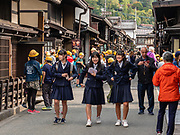"Japenese students explore the Old Town streets of Takayama. The city of Takayama (""tall mountain"") lies in the heart of the Japan Alps, in the Hida region of Gifu Prefecture. Commonly differentiated as Hida-Takayama, city has the largest geographic area of any municipality in Japan."