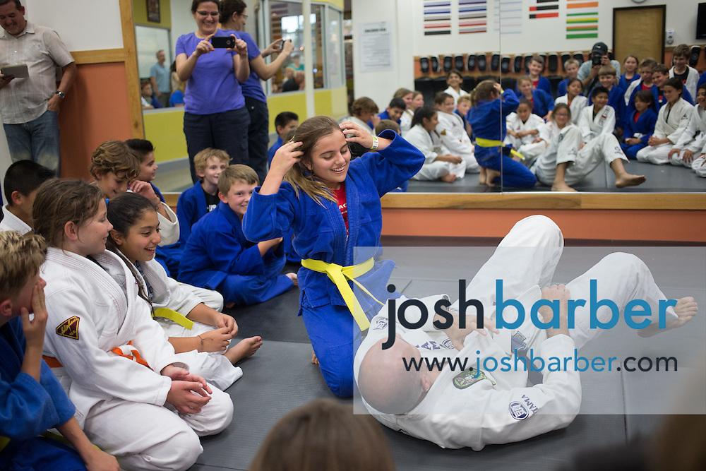 Azadeh Nicholson and Royce Gracie during a jiu-jitsu lesson at US Blackbelt Academy on Thursday, March 26, 2015 in Laguna Niguel, Calif. (Photo/Josh Barber)