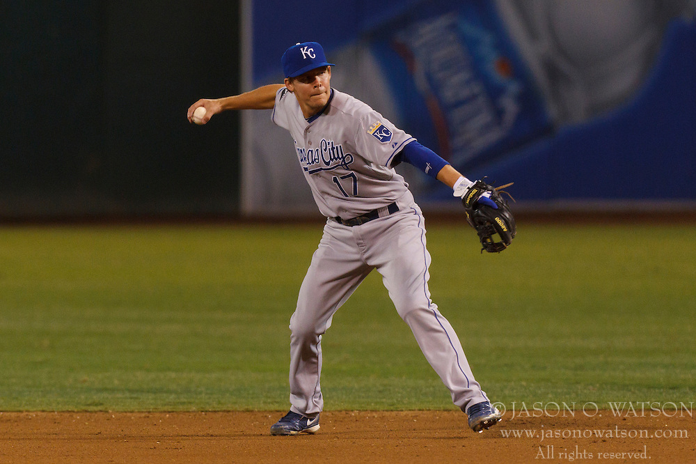 June 14, 2011; Oakland, CA, USA;  Kansas City Royals second baseman Chris Getz (17) throws to first base against the Oakland Athletics during the seventh inning at Oakland-Alameda County Coliseum.  Kansas City defeated Oakland 7-4.