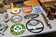 Replica cast iron metal plaques on table at auction, England, UK
