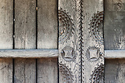 """Carved Wooden vernacular shed door detail built by """"Pasco of the Salaje"""" (county Salaj) in 1775, Berbesti, Maramures. Dimitrie Gusti National Village Museum (Muzeul Satului) in Bucharest, Romania"""