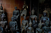 Assortent of religious and military figures, including King Rama,  on display. Situated in the heart of Bangkok, near the famous swing, is a series of streets and alleyways dedicated to the manufacture of Buddhist and Hindu icons together with other religious paraphernalia.