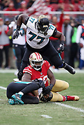 Jacksonville Jaguars offensive guard Patrick Omameh (77) leaps over the pile as Jacksonville Jaguars quarterback Blake Bortles (5) gets sacked by San Francisco 49ers defensive tackle Earl Mitchell (90) and San Francisco 49ers defensive end Solomon Thomas (94) for a loss of 2 yards in the second quarter during the 2017 NFL week 16 regular season football game against the San Francisco 49ers, Sunday, Dec. 24, 2017 in Santa Clara, Calif. The 49ers won the game 44-33. (©Paul Anthony Spinelli)