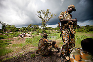 SPLA soldiers guard a camp of Central African Republic refugees fleeing the Lord Resistance Army.