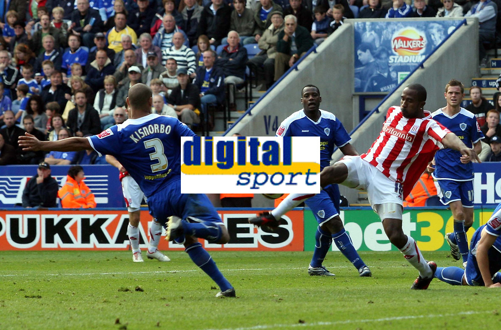 Photo: Mark Stephenson.<br /> Leicester City v Stoke City. Coca Cola Championship. 29/09/2007.Leicester's Patrick Kisnorbo (L) and Stoke's Ricardo Fuller go for the ball