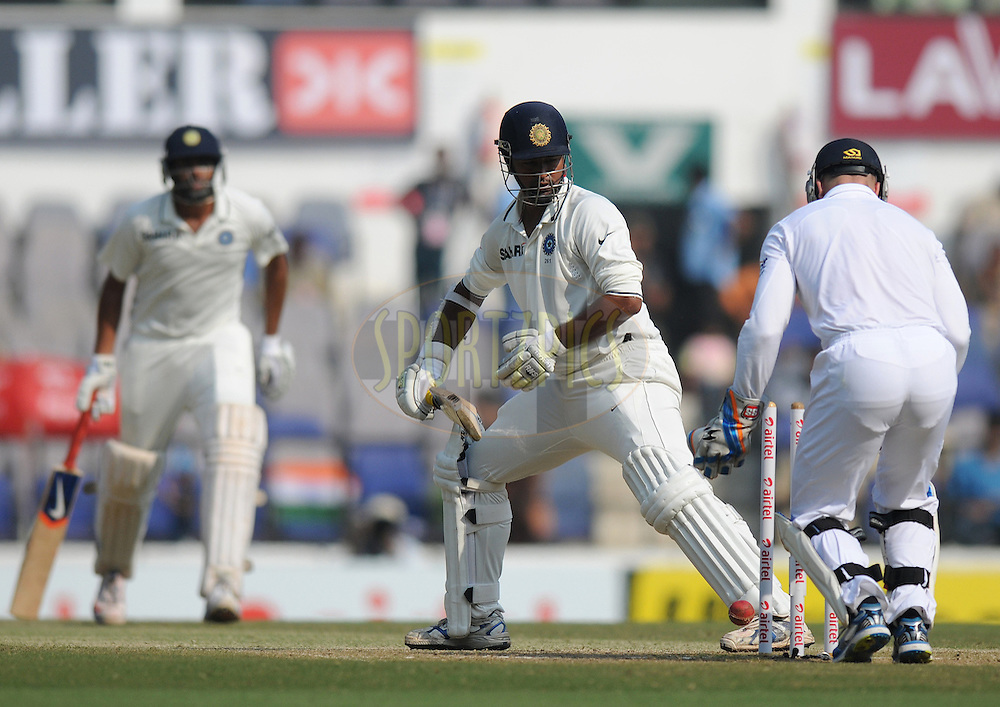Pragyan Ojha of India looks on as he gets bowled out by Monty Panesar of England during day four of the 4th Airtel Test Match between India and England held at VCA ground in Nagpur on the 16th December 2012..Photo by  Pal Pillai/BCCI/SPORTZPICS .