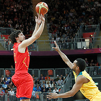 31 July 2012: Spain Sergio Llull takes a jumpshot over Australia Patrick Mills during the 82-70 Spain victory over Australia, during the men's basketball preliminary, at the Basketball Arena, in London, Great Britain.