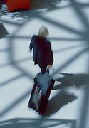 """Business traveler in motion blur as they walk through a brightly lit airport atrium. - To license this image, click on the shopping cart below - -- Determine pricing and license this image, simply by clicking """"Add To Cart"""" below --"""