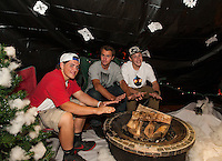 """Seniors David MacDonald, Kris Shepard and Jamie Gill take the chill off of """"Winter"""" as they set up their winter hallway on Thursday evening for Gilford High School's Four Seasons themed Homecoming.  (Karen Bobotas/for the Laconia Daily Sun)"""