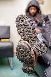A homeless person asleep in a hostel